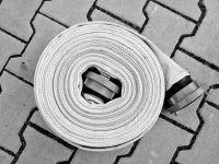 dokonale souměrně navinutá hadice připravená k uskladnění - dokonale souměrně navinutá hadice připravená k uskladnění